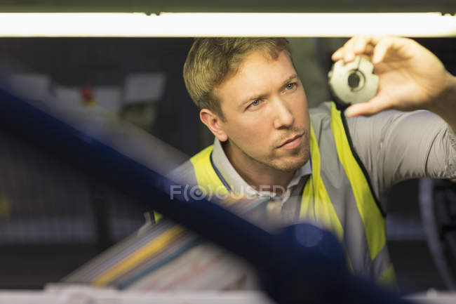 Focused worker inspecting part in steel factory — Stock Photo