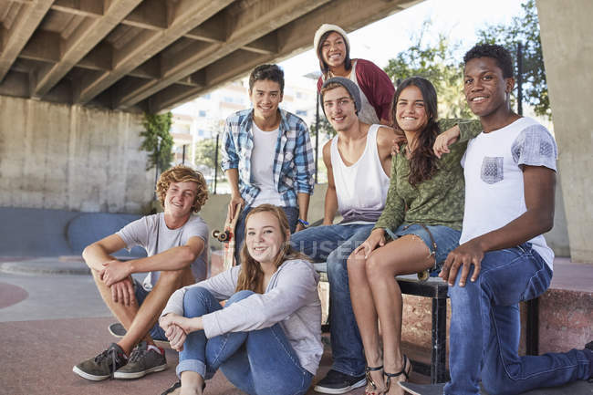 Portrait confident teenage friends hanging out at skate park — Stock Photo