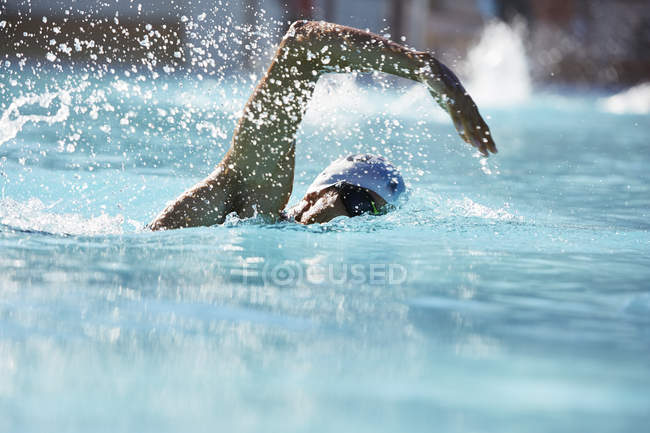 Male swimmer athlete swimming in swimming pool — Stock Photo
