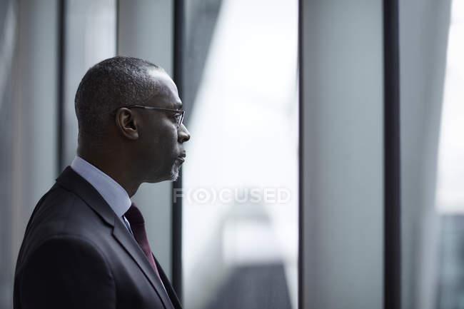 Serious pensive businessman looking away — Stock Photo