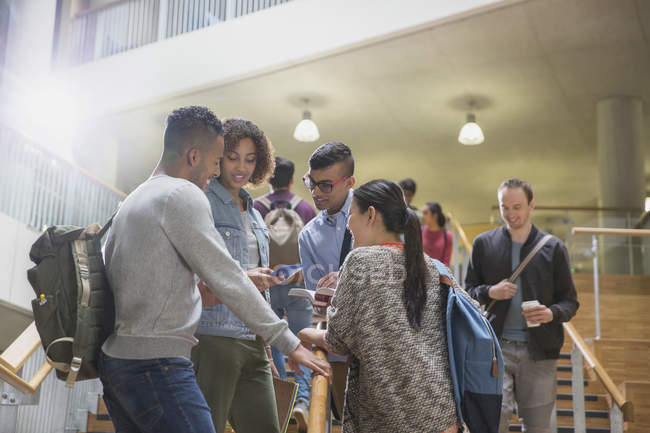 College students talking in stairway — Stock Photo
