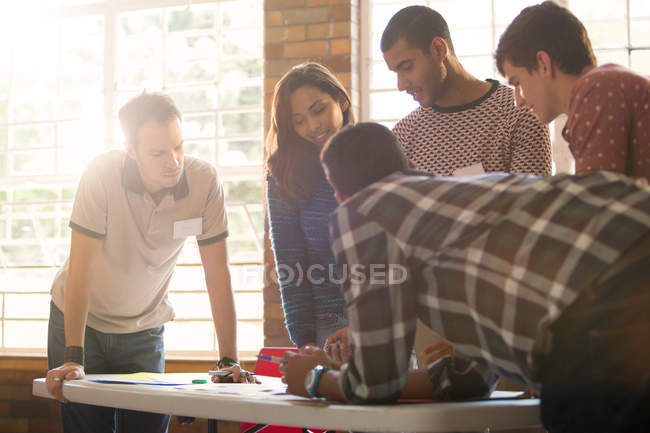 Creative business people meeting around table — Stock Photo