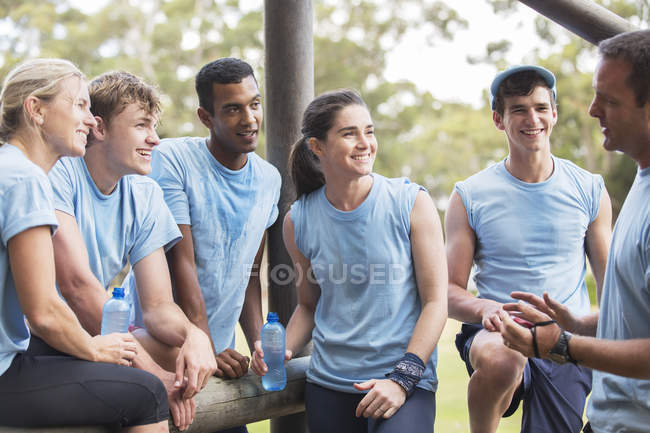 Team leader talking to teammates at boot camp — Stock Photo