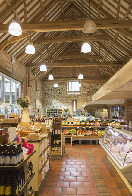 Market with vaulted wood beam ceiling — Stock Photo