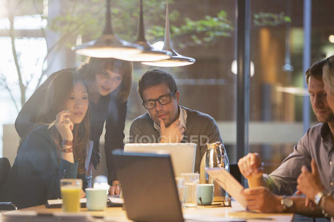 Business people using laptop in office meeting — Stock Photo