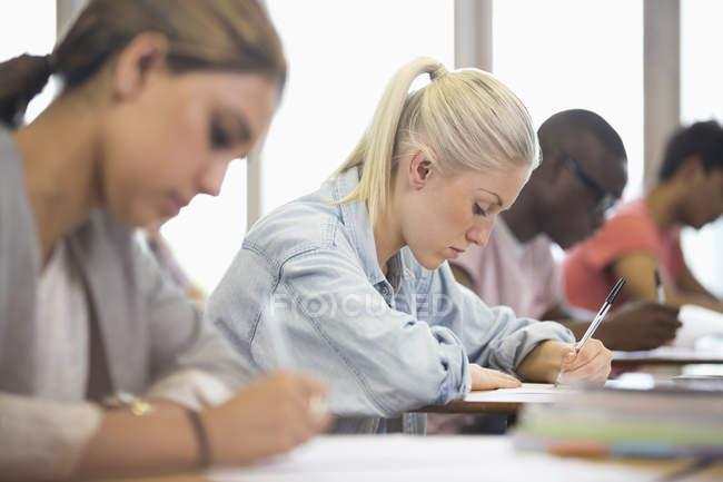 University students taking exam — Stock Photo