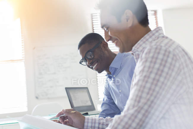 Businessmen working together in modern office — Stock Photo