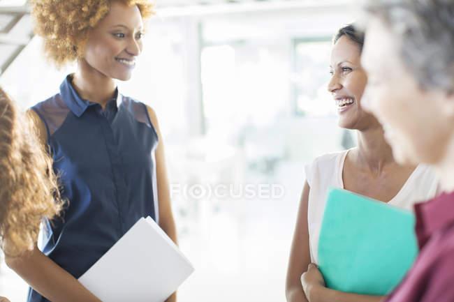 Smiling businesswomen having meeting in office — Stock Photo