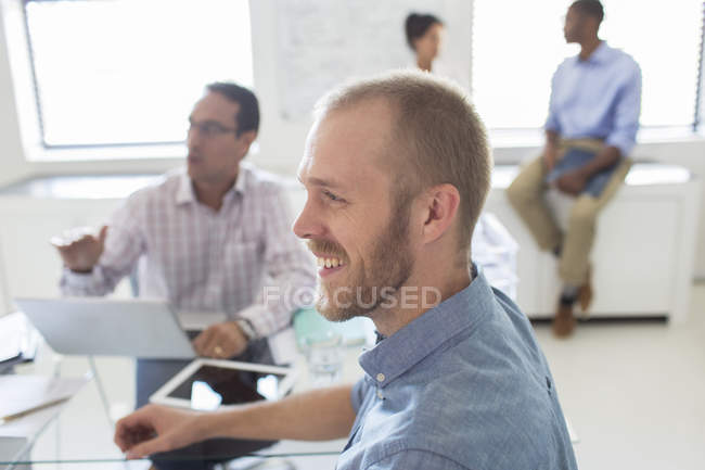 Smiling people during meeting in modern office — Stock Photo