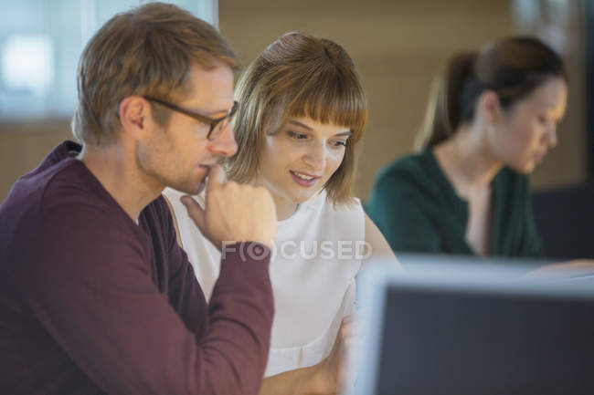 Business people working late in office — Stock Photo