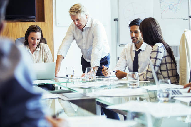 Business people having meeting in conference room, using laptop and discussing — Stock Photo