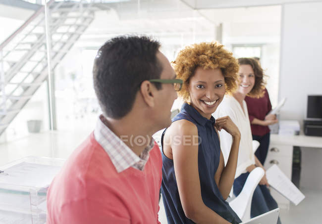 Group of smiling business people having meeting in office — Stock Photo