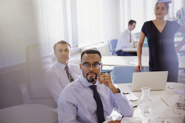 Attentive business people listening in conference room meeting — Stock Photo