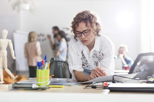 Focused female design professional planning in office — Stock Photo