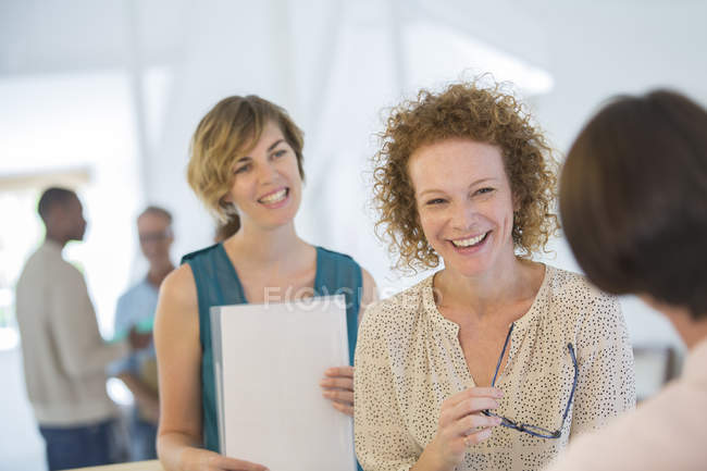 Office workers chatting and laughing during meeting — Stock Photo