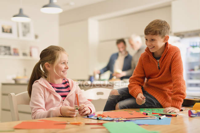 Brother and sister doing crafts at table — Stock Photo