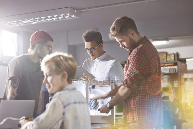 Designers using 3D printer in workshop — Stock Photo