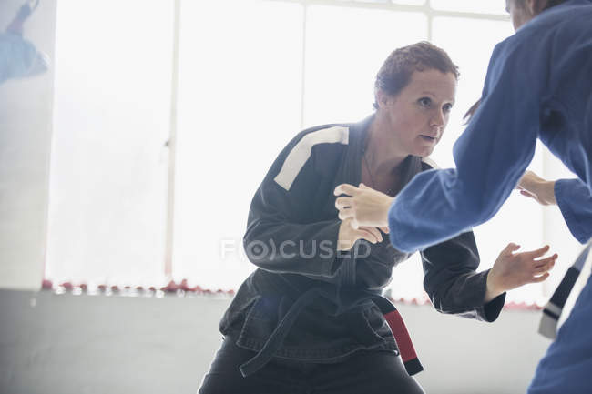 Determined, tough woman practicing judo in gym — Stock Photo