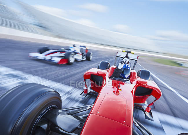 Formula one race car crossing finish line on sports track — Stock Photo