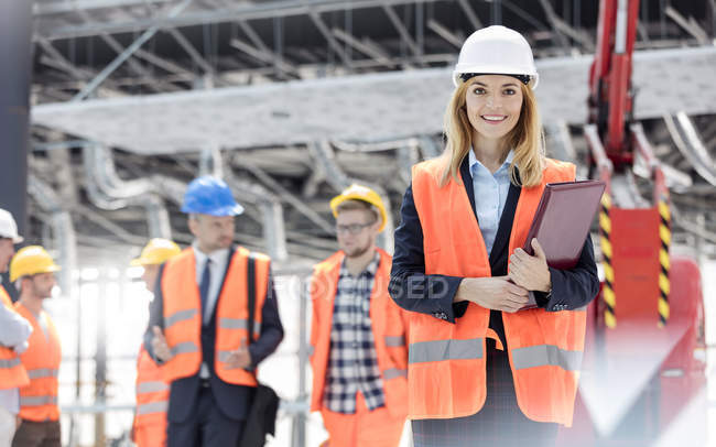 Portrait smiling female engineer at construction site — Stock Photo