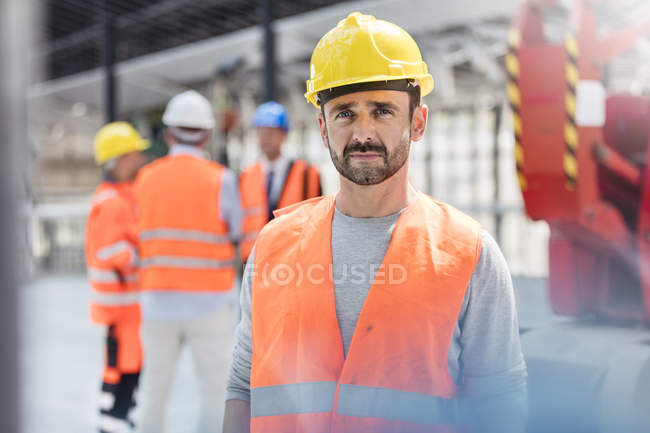 Portrait confident male construction worker at construction site — Stock Photo