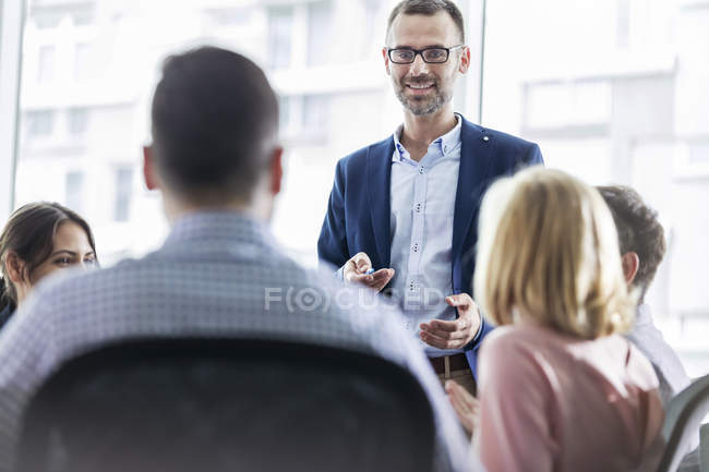 Businessman leading meeting in office — Stock Photo