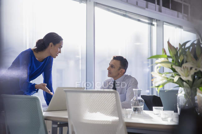 Business people working at laptop, talking in conference room meeting — Stock Photo