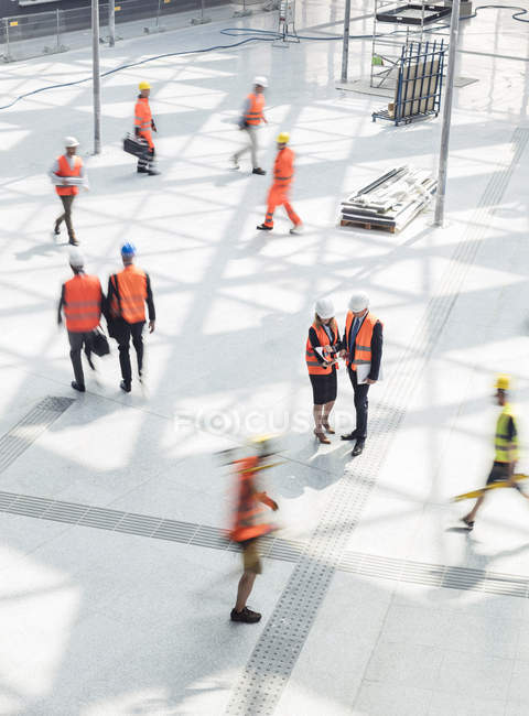 Construction workers and engineers at construction site — Stock Photo