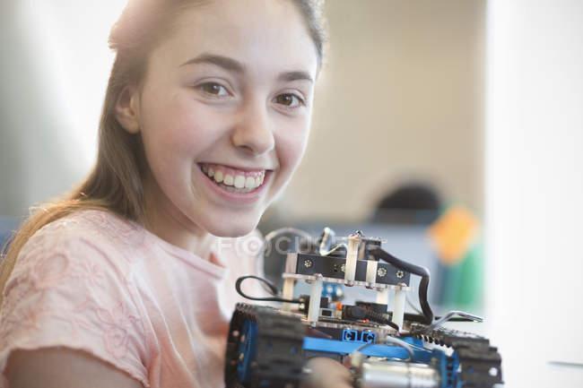 Portrait smiling, confident girl student holding robot — Stock Photo