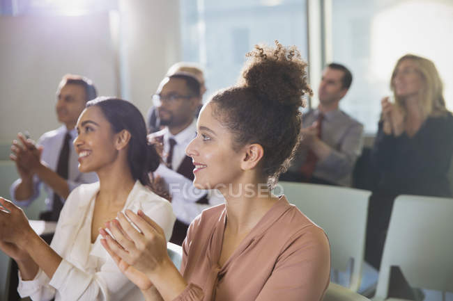Businesswomen clapping in conference audience — Stock Photo