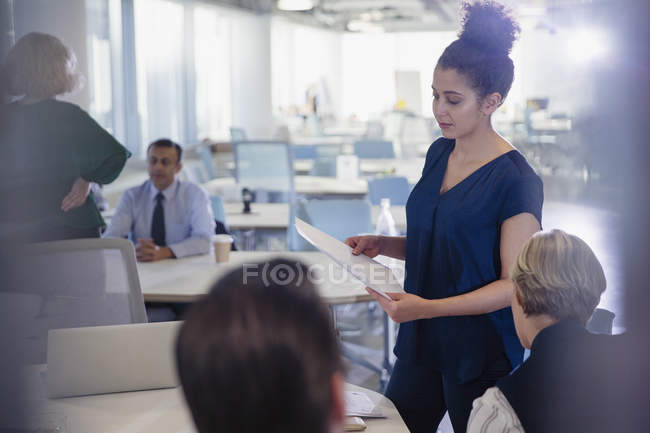Businesswoman with paperwork leading office meeting — Stock Photo