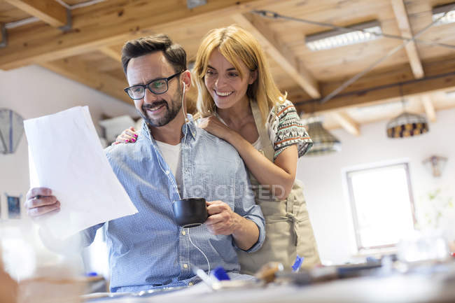 Stained glass artists reviewing drawings in studio — Stock Photo