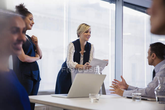 Business people discussing paperwork in conference room meeting — Stock Photo