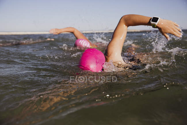 Female active swimmers at ocean outdoors during daytime — Stock Photo