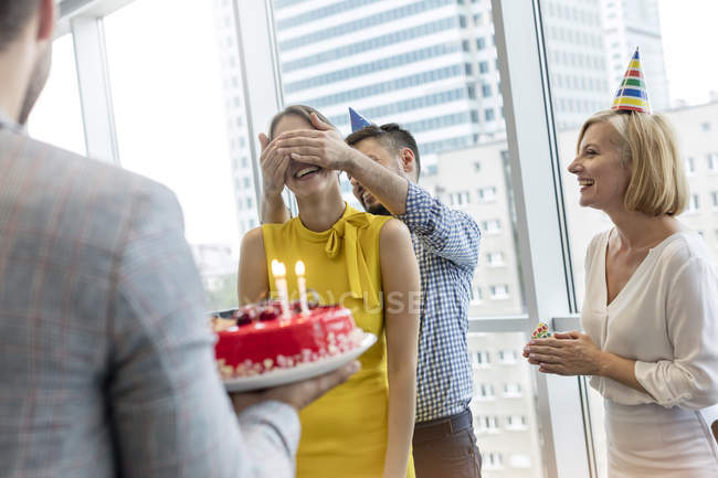 Business people celebrating birthday with cake in office — Stock Photo