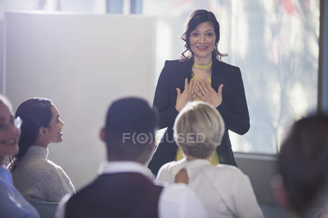 Businesswoman gesturing, leading conference meeting — Stock Photo