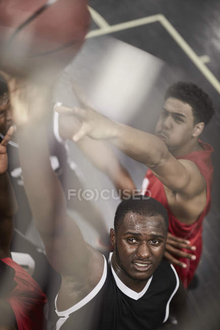 Determined young male basketball player dunking the ball — Stock Photo