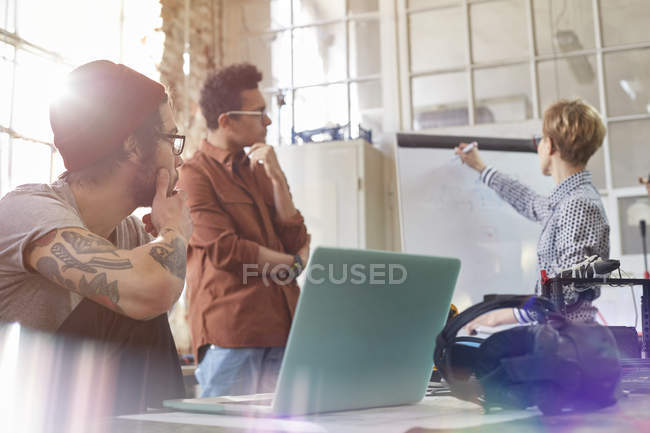 Designers meeting, brainstorming at whiteboard in office — Stock Photo