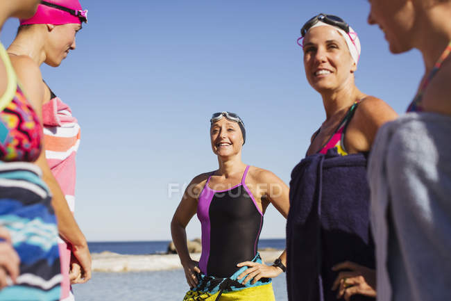 Female active swimmers standing at ocean outdoors — Stock Photo