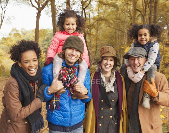 Portrait smiling multi-generation family in autumn woods — Stock Photo
