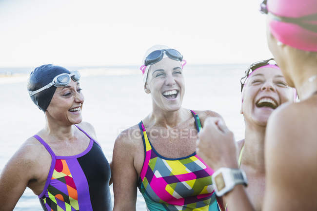 Female active swimmers smiling at ocean outdoors — Stock Photo