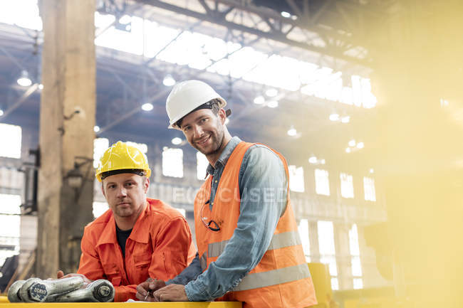 Portrait confident steel factory workers in factory — Stock Photo