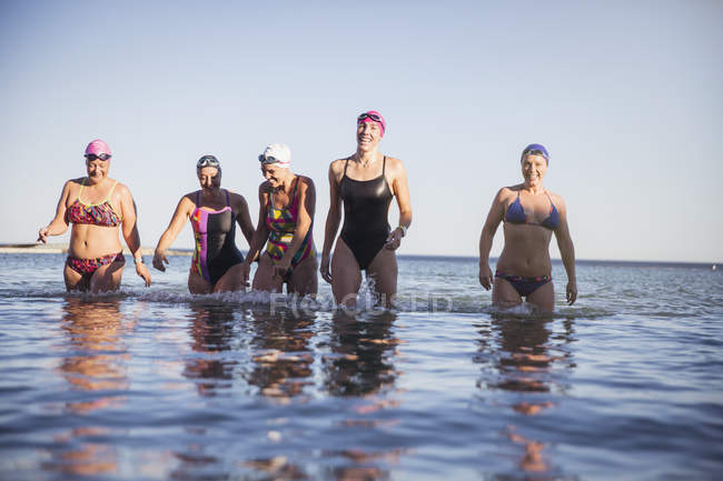 Female active swimmers at ocean outdoors — Stock Photo