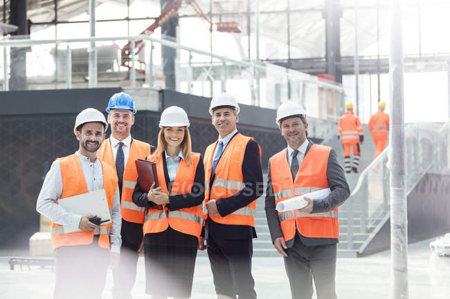 Portrait confident engineers and architects at construction site — Stock Photo