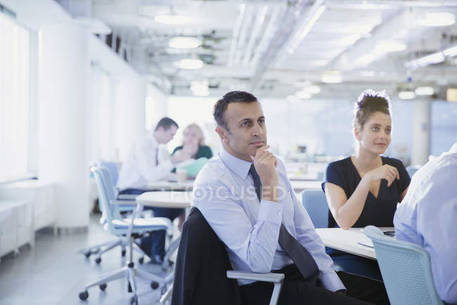 Remarkable Serious Attentive Businessman Listening In Conference Room Home Interior And Landscaping Ponolsignezvosmurscom