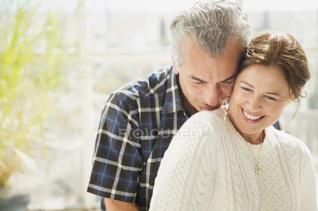 Affectionate mature couple smiling — Stock Photo