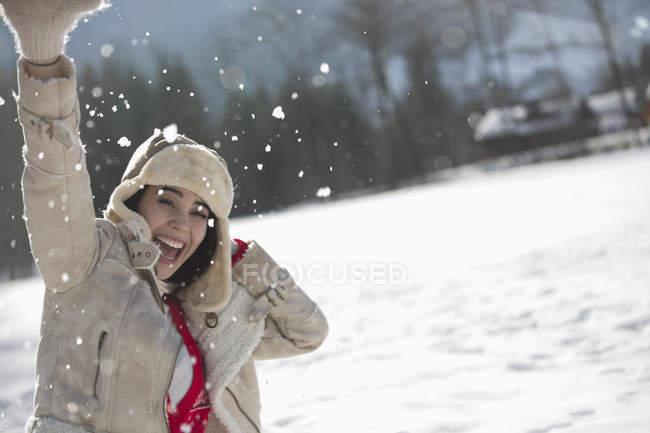 Portrait of exuberant woman in snow — Stock Photo