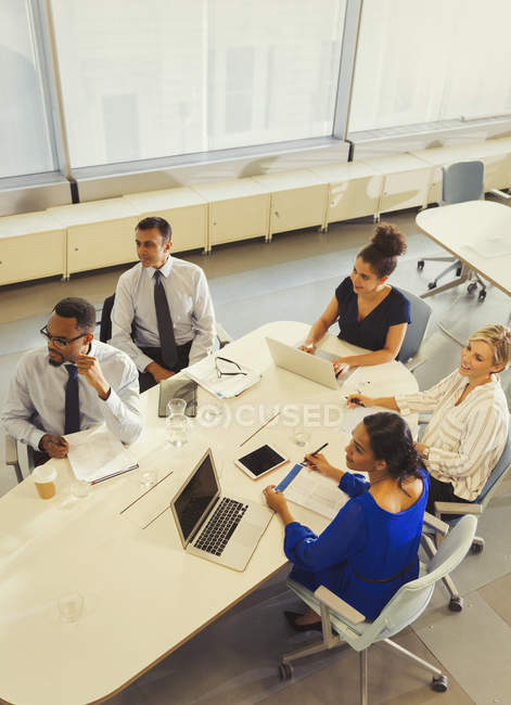 Business people working, listening in conference room meeting — Stock Photo