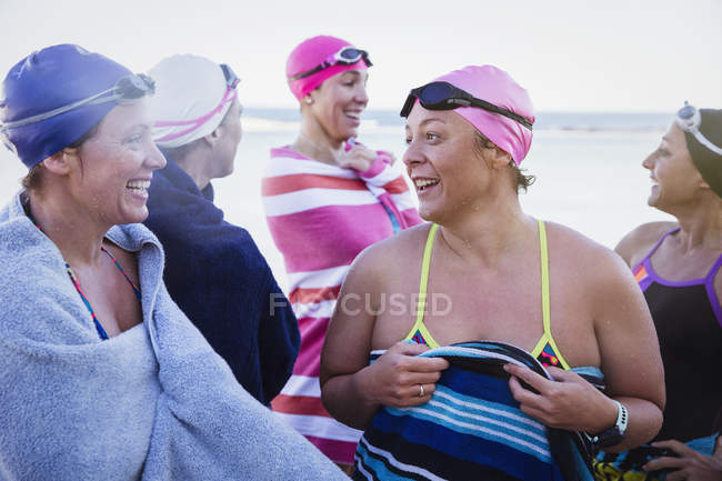 Happy Female active swimmers at ocean outdoors — Stock Photo