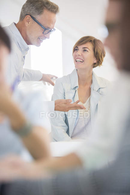 Office workers talking at meeting in modern office — Stock Photo